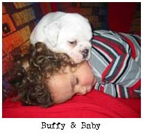baby and bulldog puppy sleeping